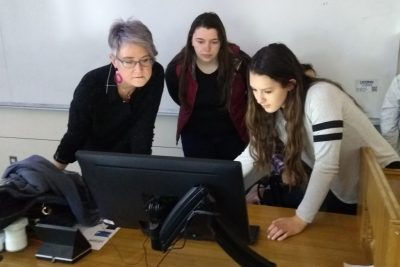 instructor and students working at computer